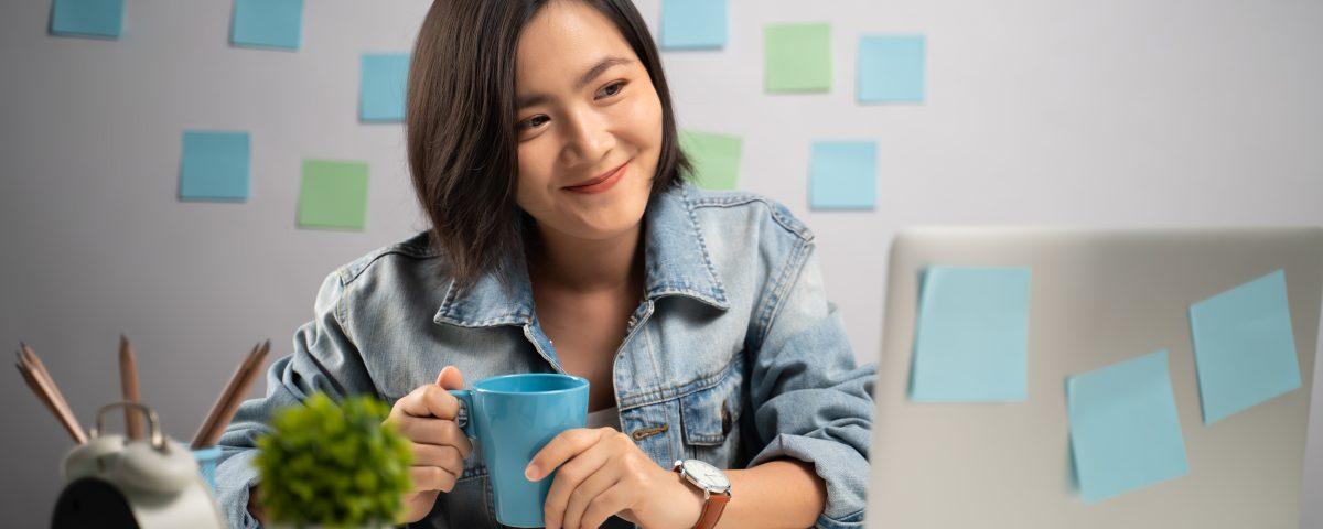 Aisan Woman Happy AT Work